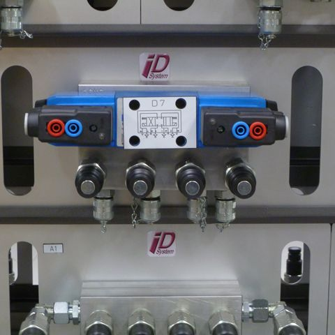 hydraulic components mounted on a drilled block in aluminum with integrated test point connectors